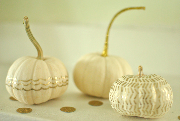 white and gold-painted pumpkins