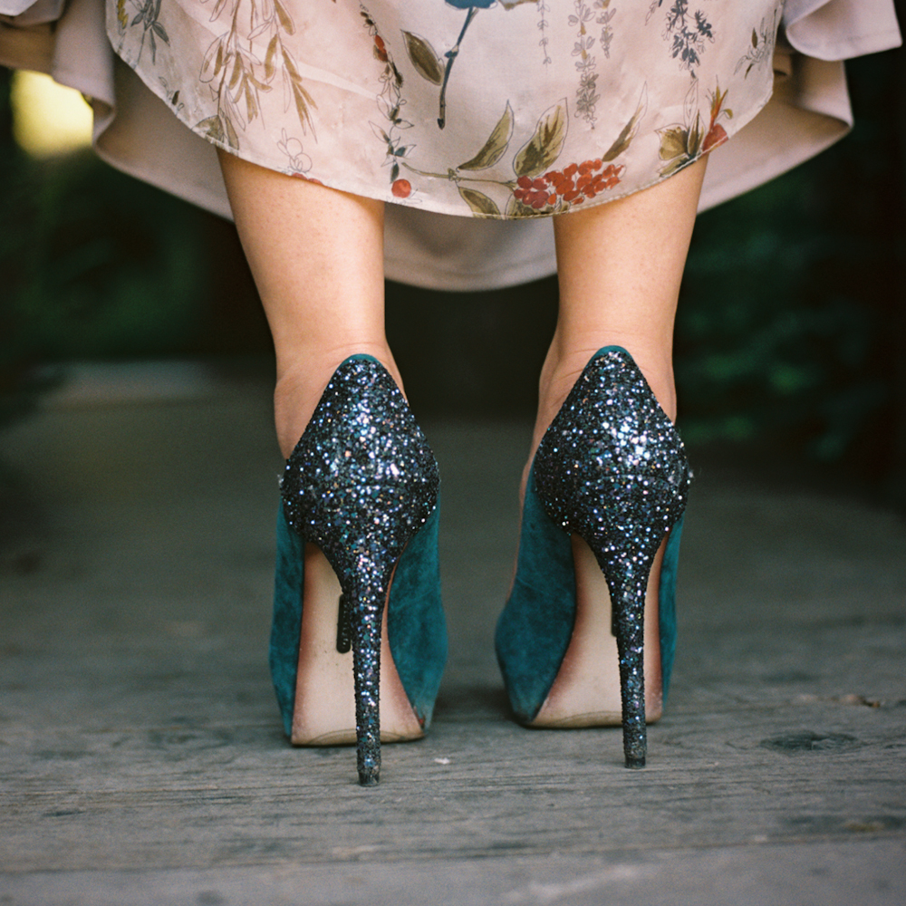 black glitter and emerald heels