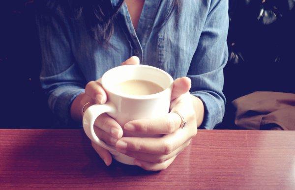 holding a coffee mug