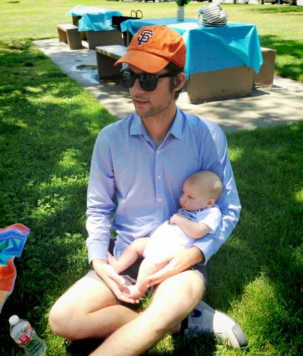 handsome men holding babies