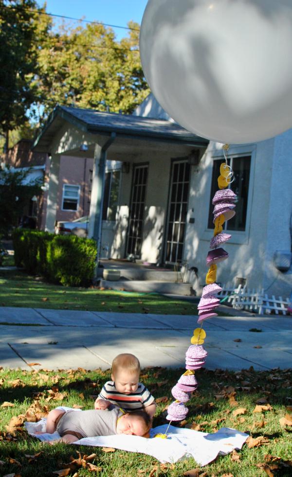 babies and jumbo balloon